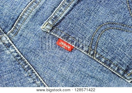 KOTA KINABALU MALAYSIA - MAY 5 2016: LEVI'S red label on the back pocket of denim jeans. LEVI'S is a brand name of Levi Strauss and Co founded in 1853.