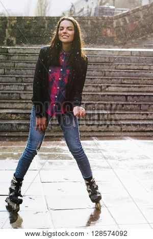 Beautiful Girl Goes For A Drive On Roller Skates In The Rain.