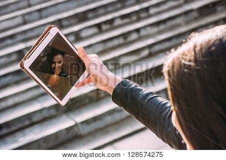 Beautiful Girl On The Street Makes Selfie