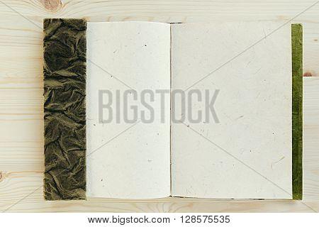 Presentation. Blank notebook. Natural sketchbook. Wood background. Background.