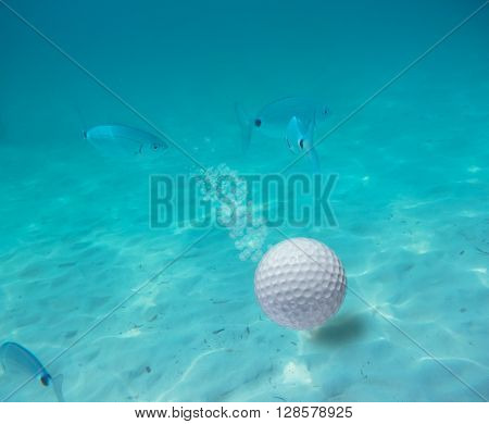 a golf ball underwater in a blue lake