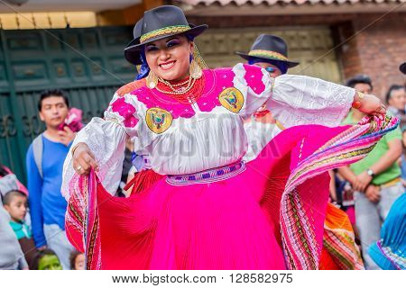 Banos De Agua Santa - 29 November : Group Of Adult Indigenous Women With Traditional Folk Costume Dancing On City Streets Of Banos De Agua Santa South America In Banos De Agua Santa On November 29