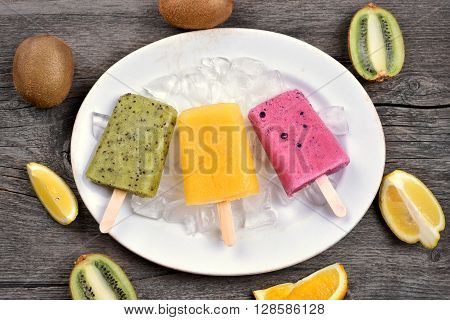 Popsicles ice cream from fruits on plate top view