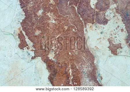 Close up photo of flagstone rock with brown and white pattern.