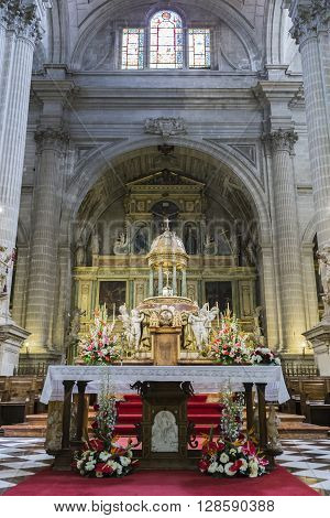 Jaen Spain - may 2016 2: High altar center of the presbyterate tabernacle bordered by four angels the work of Pedro Arnal custody made by Juan Ruiz copy of the destroyed in the civil war take in Jaen Spain