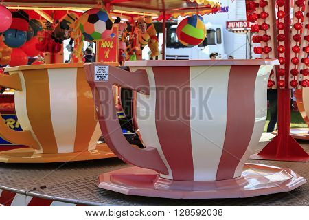 Southsea Portsmouth Uk. May 2016 .Spinning Teacup fairground ride.