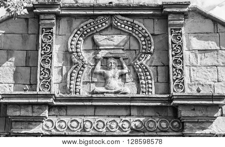 External sculpted facade of a Hindu temple.