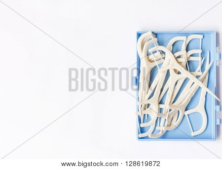 Oral Device : Dental Flossers On White Paper Background