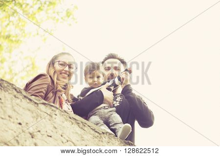 Happy Familly With Their Kid In The Park