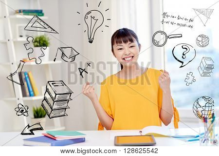 people, education, success and learning concept - happy asian young woman student with tablet pc computer, book and notepads at home over school doodles