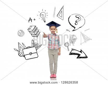 childhood, school, education, learning and people concept - happy girl with in bachelor hat or mortarboard showing thumbs up with doodles