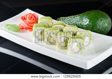 Set of traditional japanese food sushi on a dark background