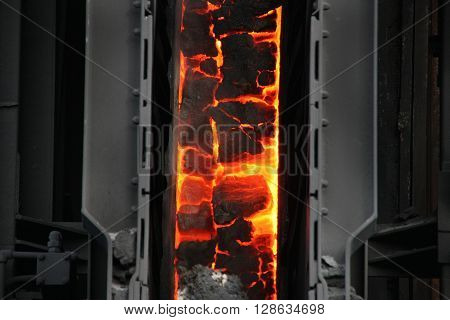 Hot coke inside oven chamber prior to pushing out.