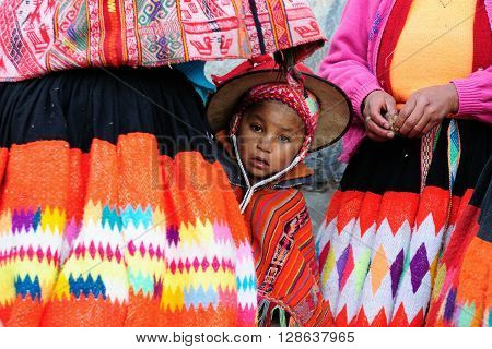 CUSCO PERU - APRIL 04: Sad and poor Peruvian children in traditional garments in the Sacred Valley in South America in April 04 2012