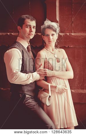 Pretty Couple On The Vintage Doorway Background.