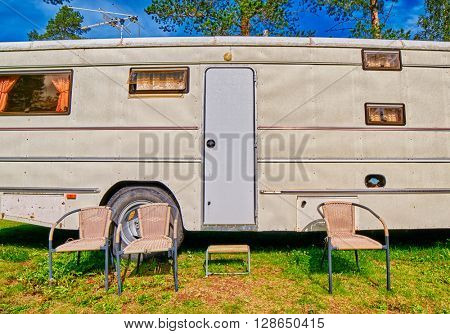 Big Old American RV / Camping Car in Pine Forest Setting