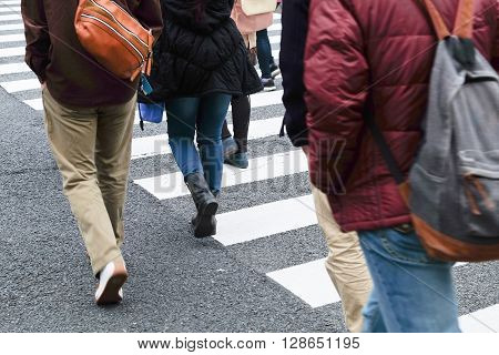 Crowd of people crossing at Ueno Hirokoji intersection, Tokyo Japan poster