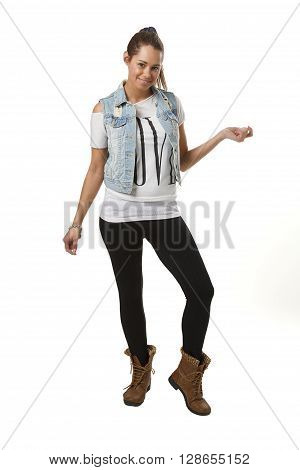 twenty something girl in trendy outfit against white background