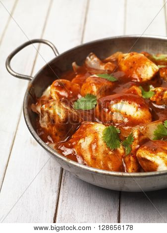 Chicken Curry on a table top in a balti bowl