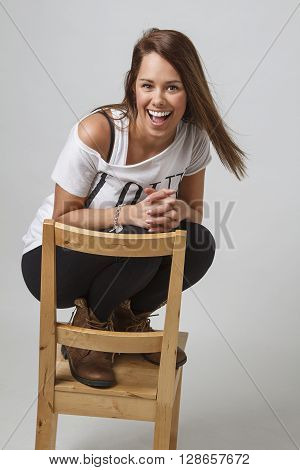 Crouching On A Chair
