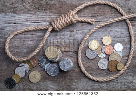 Hangman's Noose With Money On Brown Wooden Surface