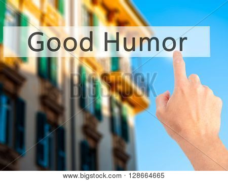 Good Humor - Hand Pressing A Button On Blurred Background Concept On Visual Screen.