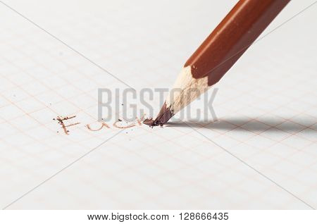 Word Fuck Being Written By Pencils On White Paper