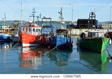 fishing boats in the bay at cobh county cork ireland