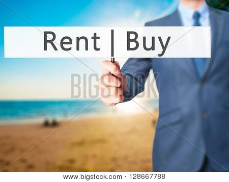 Rent Buy - Businessman Hand Holding Sign