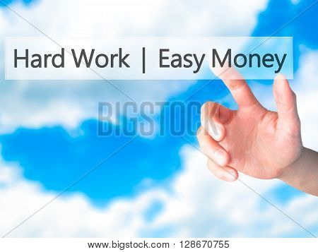 Hard Work  Easy Money - Hand Pressing A Button On Blurred Background Concept On Visual Screen.