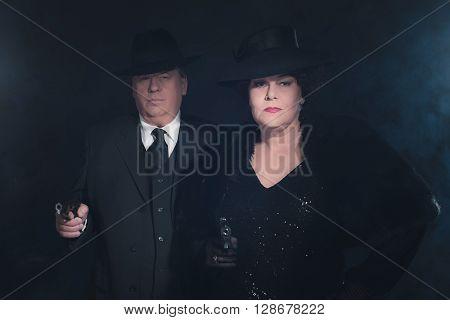 Retro 1940s gangster couple. Classic studio portrait.