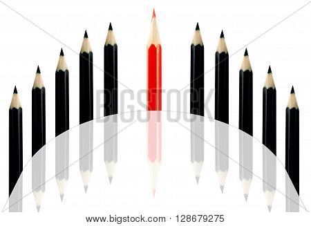 Red pencil among black pencils on a white background