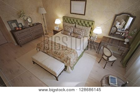 Mediterranean bedroom trend. Room with beige walls of venetian decorative plaster. Flooring of light wood and dark oak wood furniture nicely contrasts. 3D render