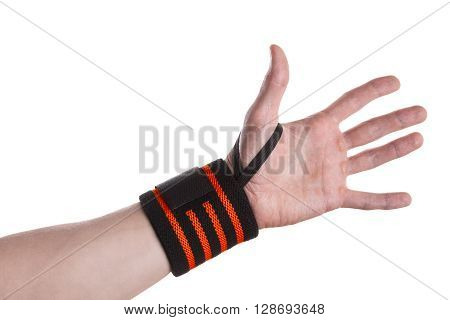 Calloused hand of a weightlifter with black and orange wrist wrap isolated on white background
