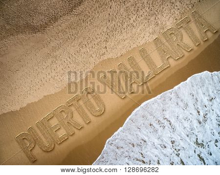 Puerto Vallarta written on the beach