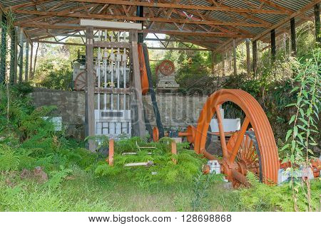 MILLWOOD SOUTH AFRICA - MARCH 4 2016: Overgrown mining equipment at the historic Bendigo gold mine at Church Millwood. All mining operations stopped in 1892