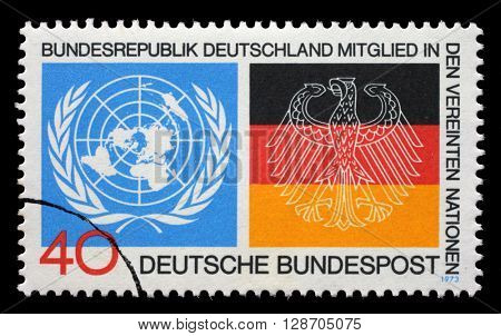 ZAGREB, CROATIA - JULY 03: a stamp printed in the Germany shows Emblems from UN and German Flags, Germany's admission to the UN, circa 1973, on July 03, 2014, Zagreb, Croatia