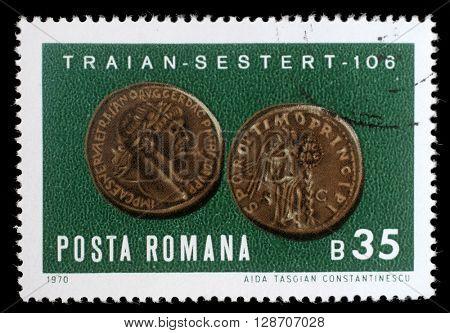 ZAGREB, CROATIA - JULY 18: stamp printed by Romania, shows Emperor Trajans copper sestertius, circa 1970, on July 18, 2012, Zagreb, Croatia