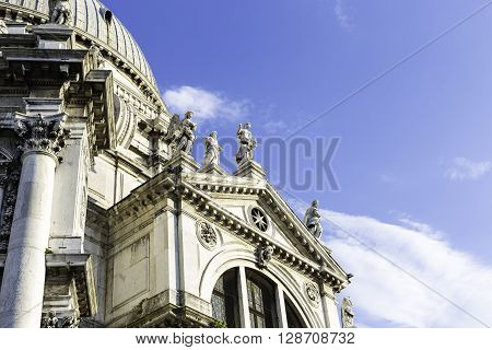 VENICE ITALY - APRIL 22 2015: Closeup view of Santa Maria della Salute which is a Roman Catholic church and minor basilica located at Punta della Dogana in the Dorsoduro sestiere of the city of Venice Italy.