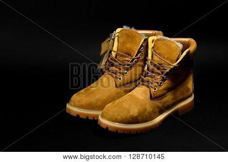 Stylish Yellow Nubuck Mens Boots On Black Background, Advertising Concept