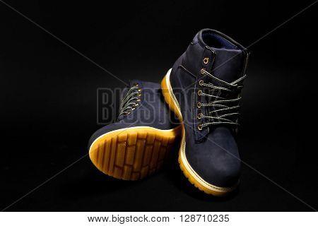 Stylish Blue Nubuck Mens Boots On Black Background, Advertising Concept