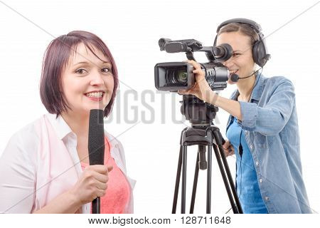 a young woman journalist with a microphone and camerawoman