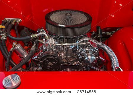 V-8 engine in a classic hot rod with chrome Fittings.