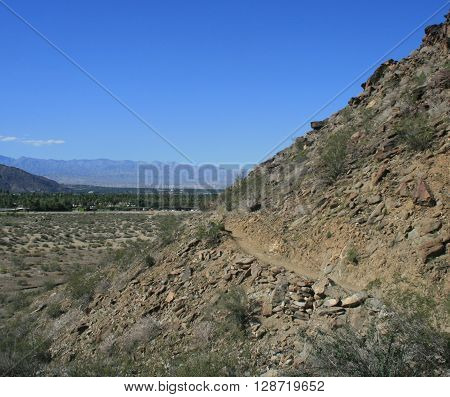 Hiking trail leading along a hillside, Palm Springs, CA