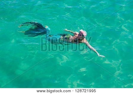 COOGEE,WA,AUSTRALIA-APRIL 3,2016: Live interactive mermaid performer swimming in the Indian Ocean water at the Coogee Beach Festival in Coogee, Western Australia.