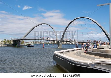 PERTH,WA,AUSTRALIA-APRIL 10,2016: Elizabeth Quay Suspension Bridge with pedestrians, elevated above the Swan River, in Perth, Western Australia.