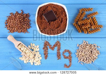 Inscription Mg ingredients and products containing magnesium and dietary fiber healthy nutrition wholemeal pasta powdery cocoa buckwheat oatmeal linseed sunflower