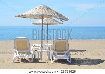 Chairs and umbrella on a beautiful tropical beach with copy space