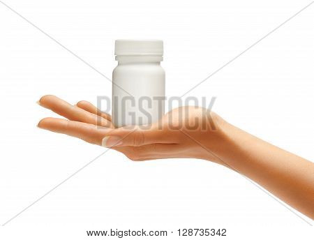 Woman's Hands with bottle for medical pills isolated on white background. Palm up close up. High resolution product.