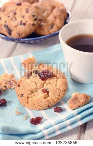 Image of dry cranberry cookies and coffeeselective focus